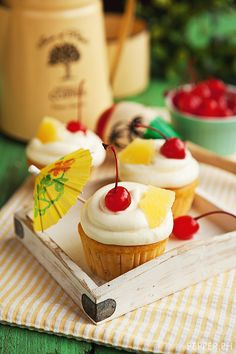 Piña Colada Cupcake with Spiked Cream Cheese Frosting #WANT