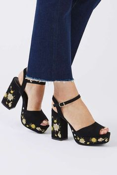 We're still loving the embroidery trend this season – seen here on a pair of black heels. The floral detail features on the heel and platform and adds a pretty touch to the party shoe. #Topshop