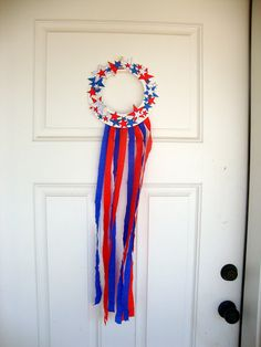 Minimal supplies needed. Cute. Thinking that kids could also wear these on their heads. Fourth of July Wreath