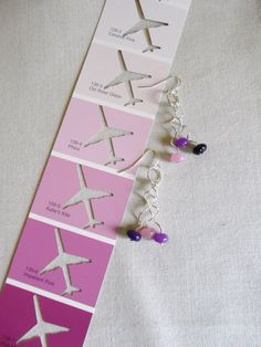 Free-formed bent silver Artistic Wire earrings with rose quartz pink, lavender and deep purple beads.