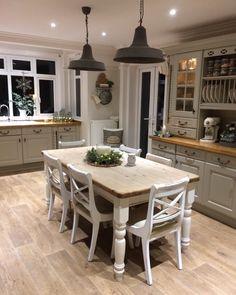 The Chic Technique: Farmhouse kitchen with white farmhouse table and light oak floor decor. Cottage Kitchens, Farmhouse Kitchen Decor, Country Kitchen, New Kitchen, Home Kitchens, Farmhouse Style, White Farmhouse, Modern Farmhouse, Kitchen Dining