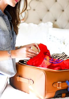 Fashion-Blogger Secrets for Packing a Carry-On || Here's how they pack light—beyond rolling clothes and preplanning outfits—without sacrificing style. Read these tips and you'll be a packing pro when you travel this holiday season.