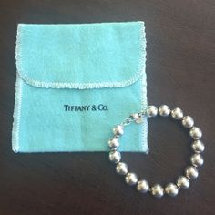 Tiffany & Co. Sterling Silver Beaded Bracelet In perfect condition. An excellent piece to add to your Tiffany obsession or to start your Tiffany collection! It comes with the Tiffany Pouch as well. Tiffany & Co. Jewelry