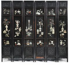 A SIX- PANEL JADE HARDSTONE AND IVORY-INLAID WOOD SCREEN CIRCA 1900 each panel divided into five panels, the central three sections embellished with the motif of 'The Hundred Antiques', including carved jade animals, panels and various vessels filled with flowering branches, all applied with various hardstones, jade and ivory, above panels carved with double-fish within a key-fret scroll