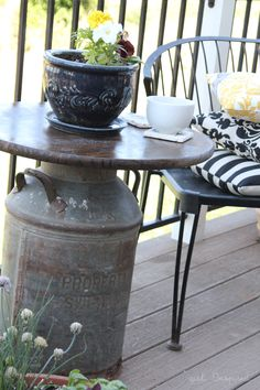 An outdoor side table made from an antique milk can!  Includes directions for adding an umbrella.