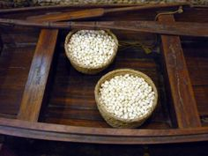 Cacoons of the silkworm Mulberry and white moths. Suzhou Silk Factory Baskets of cocoons