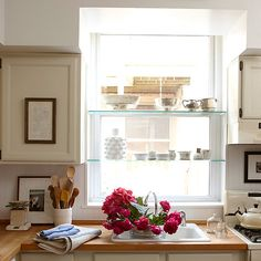 I wouldn't cut the windows in half with shelving, but otherwise love the pictures, the wooden countertops, and the abundant light!