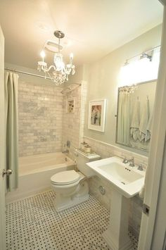small carrera marble bathroom with light greengray walls white kohler fixtures chrome basket weave floor tile and subway tile