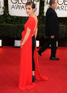In a Dior Couture dress and pants with Roger Vivier shoes and Dior earrings at the 71st Annual Golden Globe Awards in Los Angeles in 2014. See all of Emma Watson's best looks.