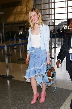 We've got all kinds of casual, easy spring and summer outfit ideas to start rocking now - how cute is Elle Fanning's ruffled midi, white tank, and classic cardigan? Click to see them all!