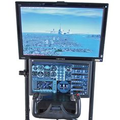 """The Cockpit Flight Simulator - Hammacher Schlemmer, Microsoft's Flight Simulator X Gold, pre-eminent flight simulation software for PCs. Includes Dell Studio XPS computer with Windows 7, software includes 23 flyable aircraft, over 70 simulated flight missions, all geographically and topographically correct. 28"""" wide-screen LCD monitor that provides 1080i high-definition resolution. 20"""" LCD monitor sits below, providing instrument panels that simulate a faithful flight experience."""