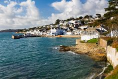 'We drove on and, as we rounded a bend, there was St. Mawes, rising steeply up from the harbour...'