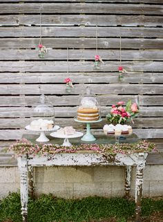cake table with hanging flowers, photo by Lauren Fair Photography http://ruffledblog.com/stonebrook-farms-bohemian-wedding #caketables #desserttable
