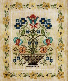 Blooming Bouquets #2 cross stitch pattern from Jeanette Douglas. A bowl of stylised flowers with a flower border. Www.artsanddesigns.com