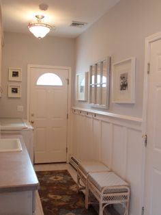 Narrow space idea. Like the sectioned mirror and clean white frames.