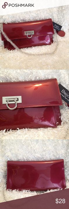 """🆕 Listing! NWT Beijo Burgundy Patent Foldover Bag NWT Bag from Beijo. 22"""" silver toned chain still in plastic, never used. Two compartments inside with one zip pocket. Measures approximately 5.5"""" x 10.5"""". Includes ID wallet. Beijo Bags Shoulder Bags"""