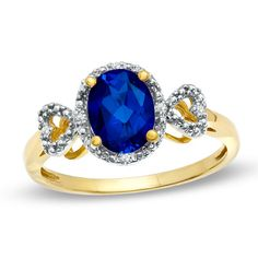 Oval Lab-Created Blue Sapphire and Diamond Accent Ring in 10K Gold