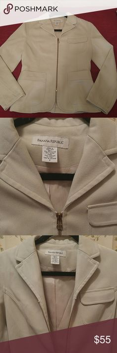 SALE! BANANA REPUBLIC FITTED TAILORED BLAZER New without tags, pristine condition. Banana Republic beige blazer. Gold Zipper in front for a fitted look. 3 front pockets. Twisted seams along sleeves and front. Fabric shell: 65% Polyester 35% Rayon, Fabric Lining: 100% Acetate. Women's Size 2. Banana Republic Jackets & Coats Blazers