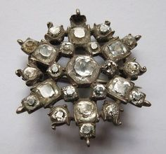 "Georgian Silver & Paste Diamond Snowflake Lace Pin Brooch c. 1810      (I pinned this because I think it would be easy to find a similar modern brooch to achieve a ""period look"" for a costume. Maybe on the front of a turban with some fabulous ostrich feathers? What do you think?)"