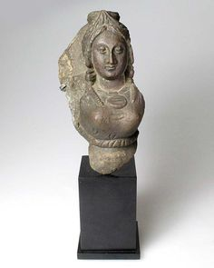 A Grey Schist Relief of the Goddess Hariti, Gandhara, ca 3rd century AD
