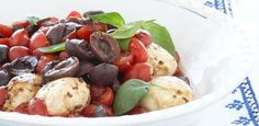 Marinated tomatoes with sweet basil and bocconcini