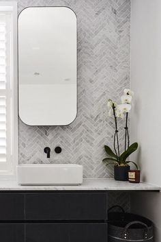The hits and misses of ensuite reveals from The Block Rectangular mirrored shaving cabinets with rounded edges and sleek black frame in bathroom. Feature herringbone marble tile wall in bathroom Bad Inspiration, Bathroom Inspiration, Bathroom Styling, Bathroom Interior Design, Minimalist Bathroom Design, Interior Walls, Simple Bathroom, Bathroom Black, Bathroom Marble
