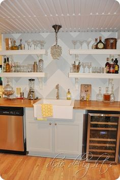 Take out sink and a thought for beverage station in basement...look for paint from this blog. Love her befores and afters! Lots of great ideas for my home:)