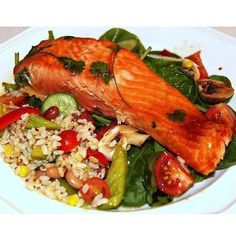 MARINADE SALMON WITH BROWN RICE AND QUINOA SALAD BY: @funkyfitnessfoods For the salmon- 1 filet of salmon 1tbs sweet chili sauce 1tbs soy sauce 1tsp rice wine vinegar 1 handful corriander For the salad- 1 cup cooked brown rice and quinoa mix 1 corn on the cob 1/2 cup four bean mix 1 cucumber 1/2 a capsicum Green beans, chopped 1/2 cup cherry tomatoes 2 tbs wholegrain seeded mustard 1/4 cup vinegar Preheat oven to 180 degrees celcius. In a bowl, mix the soy sauce, sweet chili sauce, vinegar…