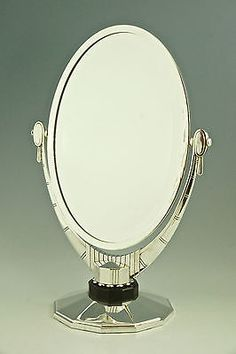 An oval Art Deco silver plated table mirror Atelier Raynaud France 1930, 26 inch