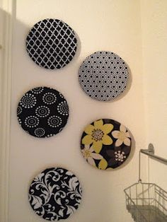 Fabric covered cork trivets (from Ikea) used as bulletin boards.