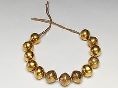 INCA NECKLACE  Hollow gold beads  Inca   Cajamarca, Peru; AD 1450-1532   American Museum of Natural History, Anthropology