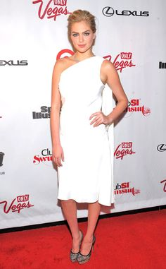 Kate Upton dons an angelic one-shoulder dress, while attending a Sports Illustrated party at 1 OAK Nightclub in Las Vegas.