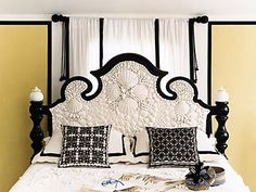 The top floor's master bedroom is accented with black and yellow and glue-gunned to the max, with a profusion of white shells covering the ebonized headboard and filling several old picture frames artfully arranged on the wall    Read more: http://www.oprah.com/home/O-at-Home-Spring-2005_1/3#ixzz1uY0pS6ZP