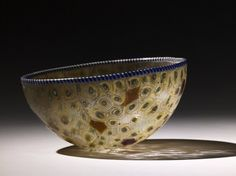 ancientpeoples:Cast polychrome millefiori glass bowl 200-100 BC Roman (Source: The British Museum)