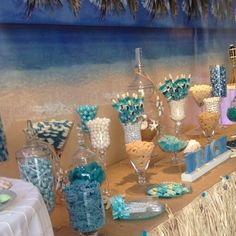 I just love the #backdrop for this #beach themed #candybar. #downbythesea #summerwedding #batmitzvah #blue #sea #ocean #candyporn #instayum #candy #candybuffet #candybarcouture