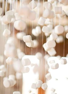 Falling snow- string marshmallows for this fun garland effect.  Oh my, what kid wouldn't love to string up some marshmallows to make snow?