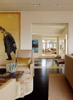 Love the openness, long view, the cream walls,  big art, floor to ceiling windows and light colored furniture