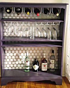 Turn an old bookshelf into a bar. Would work for the basement pub I want...by until we get a real wet bar, of course ;)