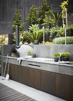 Outdoor pizza oven in a terraced garden