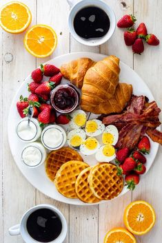 This easy breakfast board with bacon, eggs and fresh fruit is the perfect fuss-free, versatile breakfast or weekend brunch for serving a crowd and great for the holidays. #Christmas #Thanksgiving #entertaining #breakfast #brunch #breakfastboard #breakfastparty #eggs #bacon #waffles