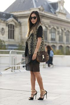 Aimee Song of Song of Style wearing Finders Keepers the label's Fatal Attraction Skirt in Black during Paris Fashion Week.