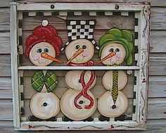 Snowmen painted on an old window - Cute!