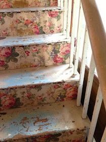 Old steps to chic: cover the risers with a vintage fabric adhered with wall paper paste on the stair part, smooth, dry.  Voila! Can be removed later if you want to change decor.