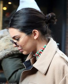 Touch of glitz: Kendall's right earring glinted in the sunlight
