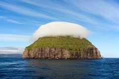 Cloud-covered island of Litla Dimun, Faroe Islands
