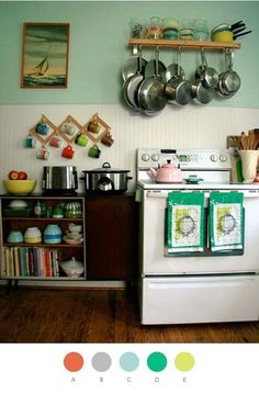 this is too cute.  That looks like one of our ship paintings.  I love everything about this kitchen except I wouldn't be able to have the dishes and books so low because of rugrats.