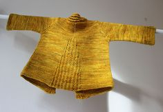 Ravelry: Tricsi pattern by Åsa Tricosa. The back of a baby cardigan. 3 months to 10 years
