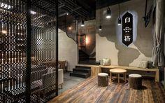 En Vain Baijiu Bar by united design practice using wooden beam as floor design