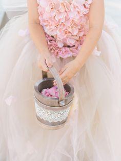 Pretty in pink flower girl, wooden bucket of petals, tulle skirt // Care Studios