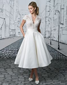 The options are endless with this two piece set. The short sleeved V-neck bodice tucks perfectly into the Silk tea length ball gown skirt. A Mikado skirt version is also available as style 8881A. Full length skirt options are available in Silk as 8881F or Mikado as 8881AF.